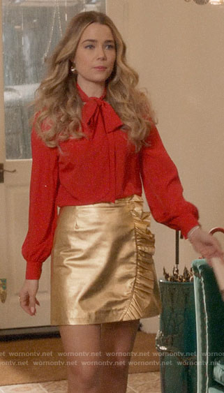 Ainsley's red embellished blouse and gold skirt on Four Weddings and a Funeral
