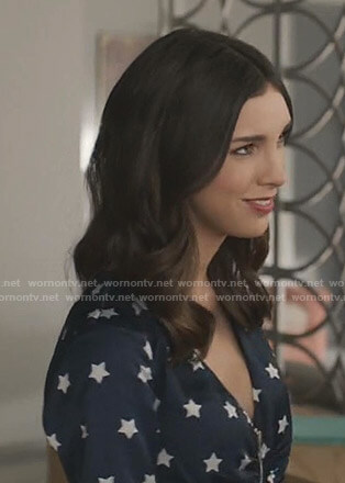 Alicia's navy star print v-neck dress on Grand Hotel