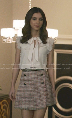 Alicia's pink tie neck top and tweed skirt on Grand Hotel
