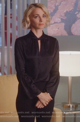 Lizzie's black twist neck blouse on Instinct