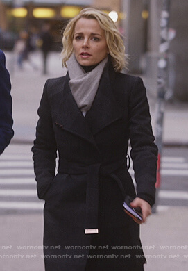 Lizzie's black wrap coat on Instinct