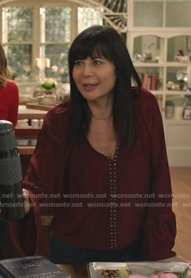 Cassie's red studded v-neck top on Good Witch