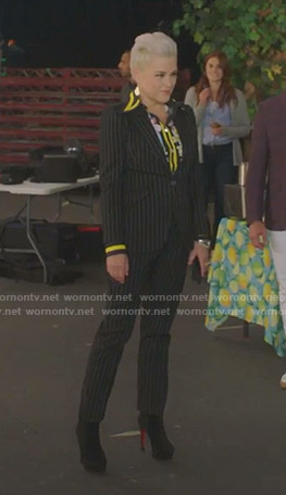 Christine's floral blouse and black pinstriped suit on BH90210