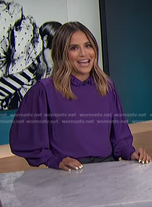 Erin's purple ruffled blouse on E! News