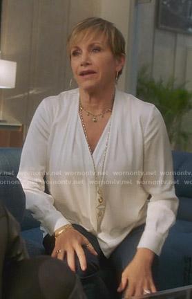 Christine's black lace-up blazer on BH90210
