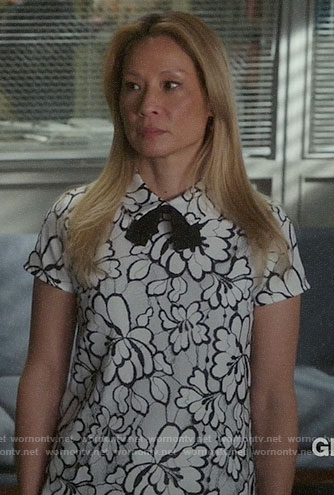 Joan's white lace collared top on Elementary