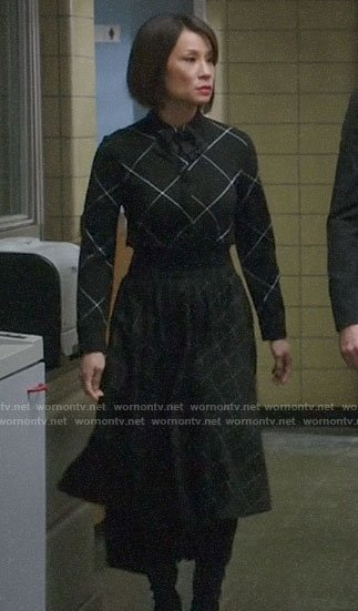 Joan's black mixed check dress on Elementary