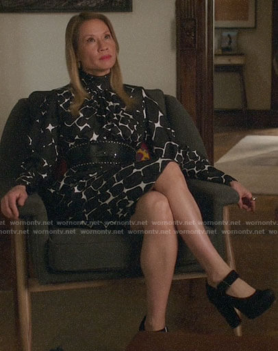 Joan's black and white geometric print dress on Elementary