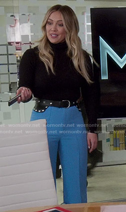 Kelsey's blue wide-leg pants and studded belt on Younger