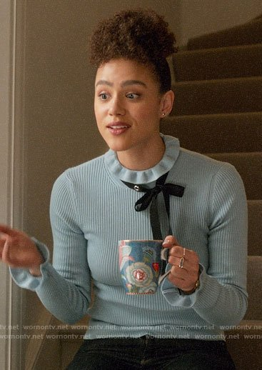 Maya's blue sweater with studded neck bow on Four Weddings and a Funeral