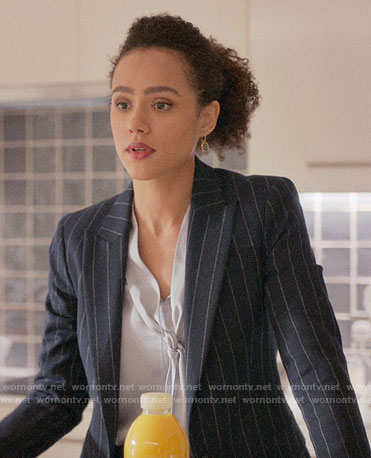 Maya's pinstripe suit and tie neck blouse on Four Weddings and a Funeral