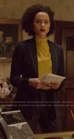 Maya's yellow blouse and pinstripe suit on Four Weddings and a Funeral
