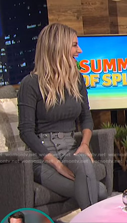 Morgan's grey sweater and button detail pants on E! News Nightly Pop