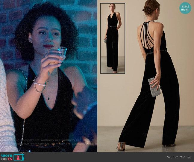 Reiss Hailie Velvet Jumpsuit worn by Maya (Nathalie Emmanuel) on Four Weddings & a Funeral