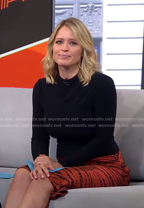 Sara's orange zebra print skirt on GMA Strahan And Sara