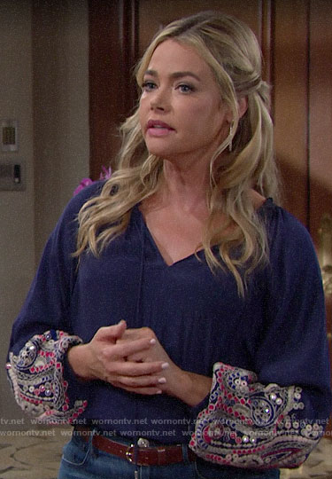 Shauna's blue blouse with embellished sleeves on The Young and the Restless