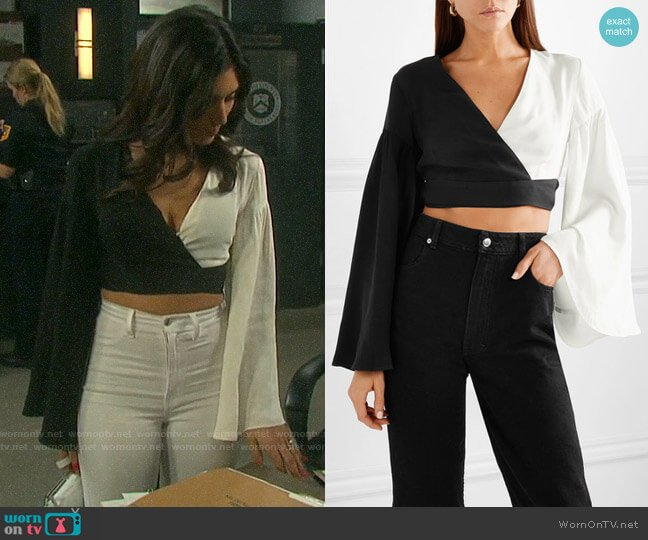Staud Cropped two-tone crepe de chine wrap top worn by Gabi Hernandez (Camila Banus) on Days of our Lives