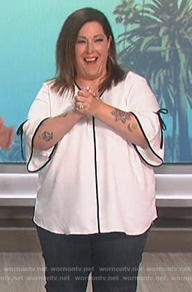 Carnie Wilson's white contrast tie sleeve blouse on The Talk