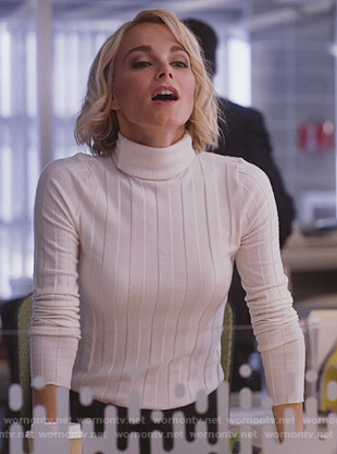 Lizzie's white ribbed turtleneck sweater on Instinct