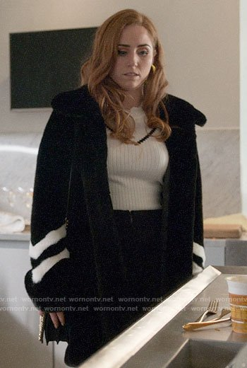 Zara's black fur coat with striped sleeves on Four Weddings and a Funeral