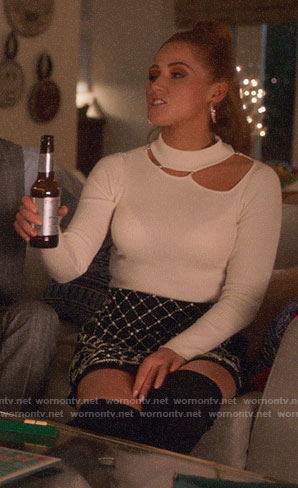 Zara's white cutout sweater and beaded skirt on Four Weddings and a Funeral