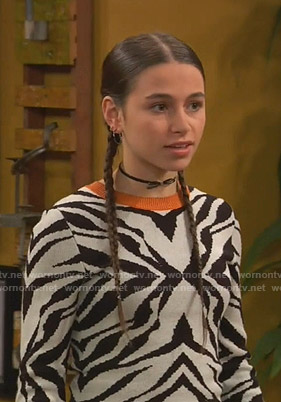 Tess's white zebra sweater on Ravens Home
