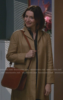 Amelia's striped blouse and beige coat on Greys Anatomy