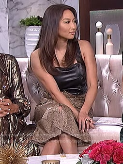 Jeannie's black leather top and snake print skirt on The Real