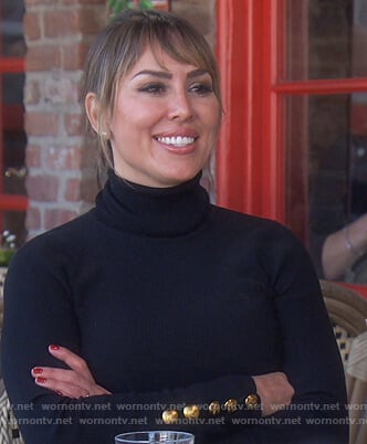 Kelly's black button cuff sweater on The Real Housewives of Orange County