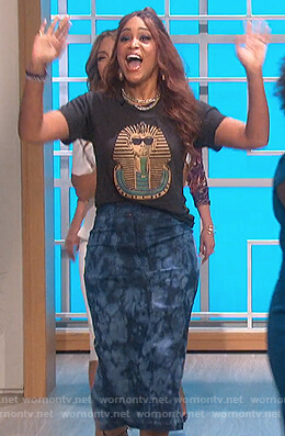Eve's black pharoh print tee and denim skirt on The Talk