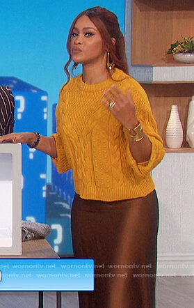 Eve's yellow sweater and satin skirt on The Talk