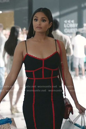 Carolina's black dress with red trim on Grand Hotel