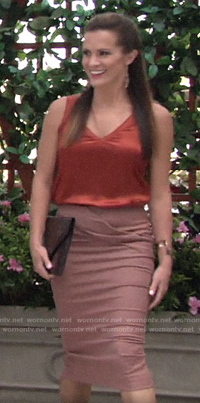 Chelsea's orange v-neck top and pink pencil skirt on The Young and the Restless