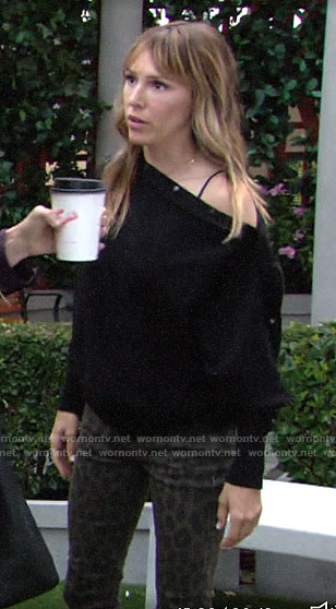 Chloe's black sweater with snap buttons and leopard jeans on The Young and the Restless