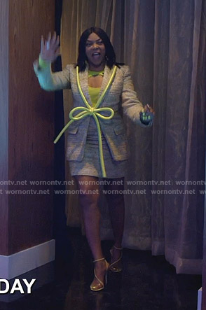Cookie's yellow teed skirt suit with tie on Empire