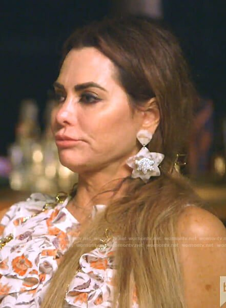 D'Andra's white dropped earrings on The Real Housewives of Dallas