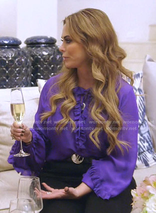 D'Andra's purple ruffled blouse on The Real Housewives of Dallas