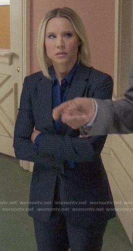 Eleanor's navy striped suit on The Good Place