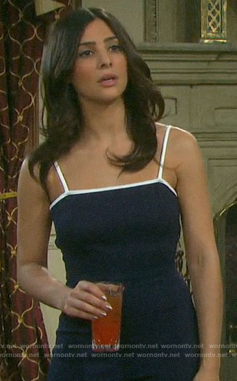 Gabi's navy jumpsuit with white trim on Days of our Lives