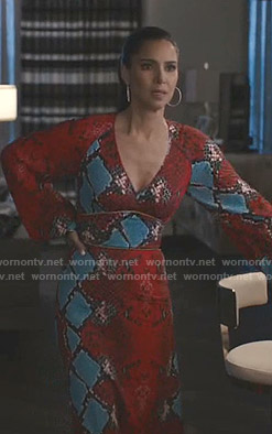Gigi's red snake print v-neck dress on Grand Hotel