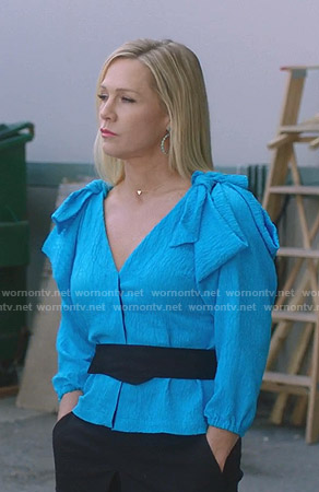 Jennie's blue bow-shoulder top on BH90210