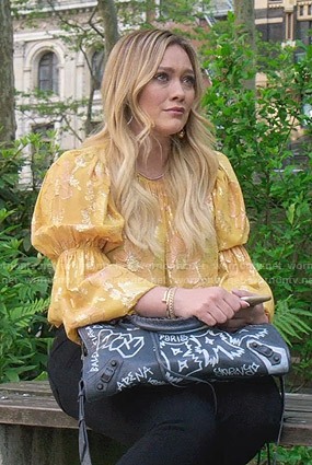 Kelsey's yellow floral blouse on Younger
