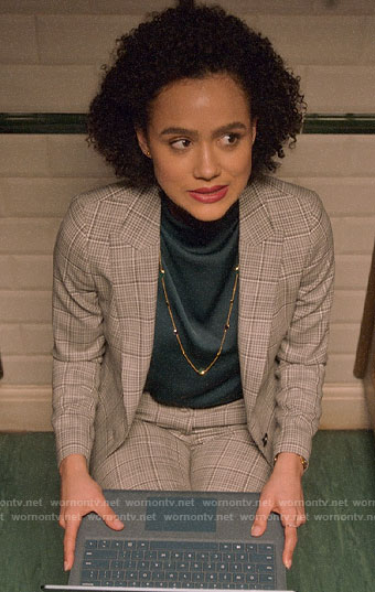 Maya's plaid suit and draped top on Four Weddings and a Funeral