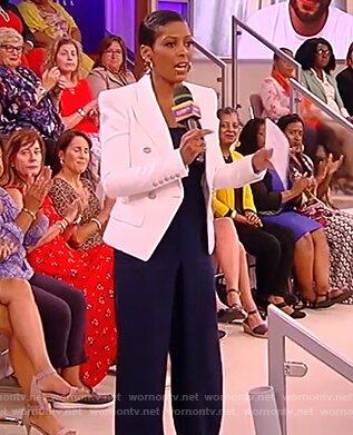 Tamron's blue jumpsuit and white blazer on the Tamron Hall Show