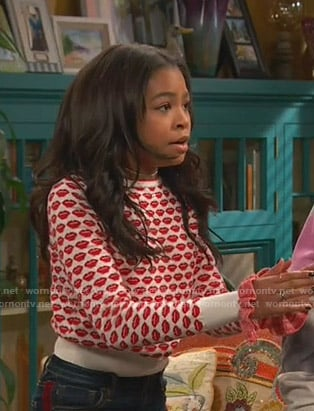 Nia's white and red lip print sweater on Ravens Home