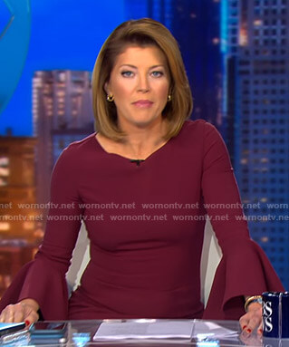 Norah's burgundy bell sleeve dress on CBS Evening News