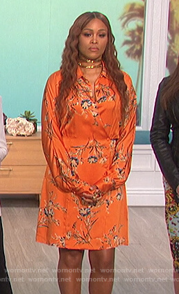 Eve's orange floral print wrap dress on The Talk