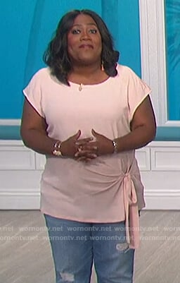 Sheryl's pink tie front top on The Talk