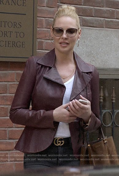 Samantha's burgundy leather jacket and black jeans on Suits