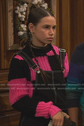 Tess's black and pink checkerboard chunky sweater on Ravens Home